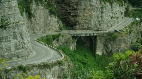 Car driving along a road on the Amalfi Coast