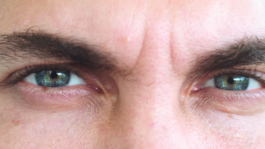 Serious Male Eyes. Extreme Close Up