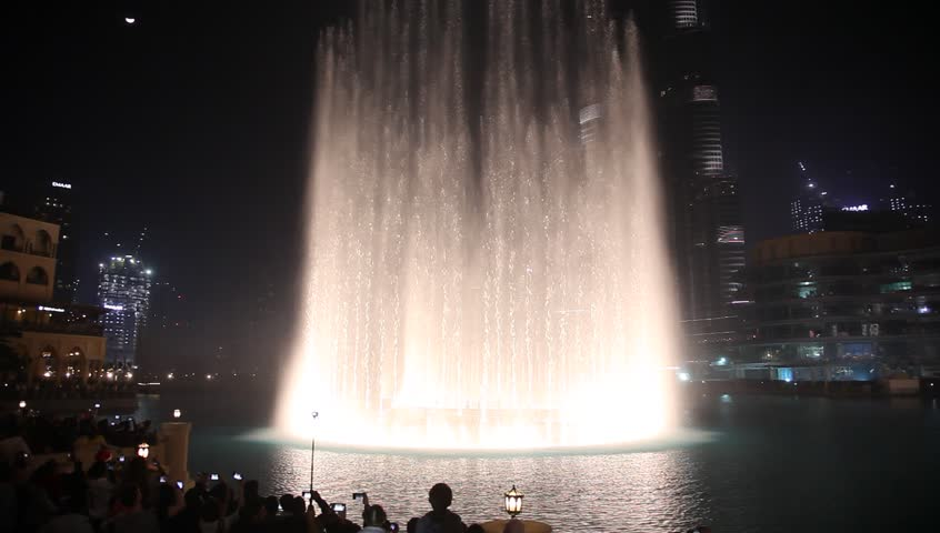 Dubai, United Arab Emirates. December 25, 2017. Night city, panoramic view -  Dubai Dancing fountain. People watch the show. | Shutterstock HD Video #34714882