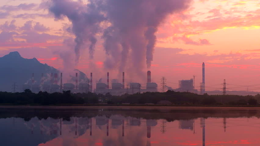 Power plant with sunrise and smoking coal    Shutterstock HD Video #34735042