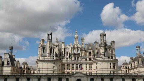 Château Chambord, Loire Valley, Cloudy Blue Sky, French Flag Flying.