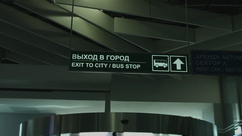 "Pointer at the airport ""exit to city, bus stop"", sign arrow"