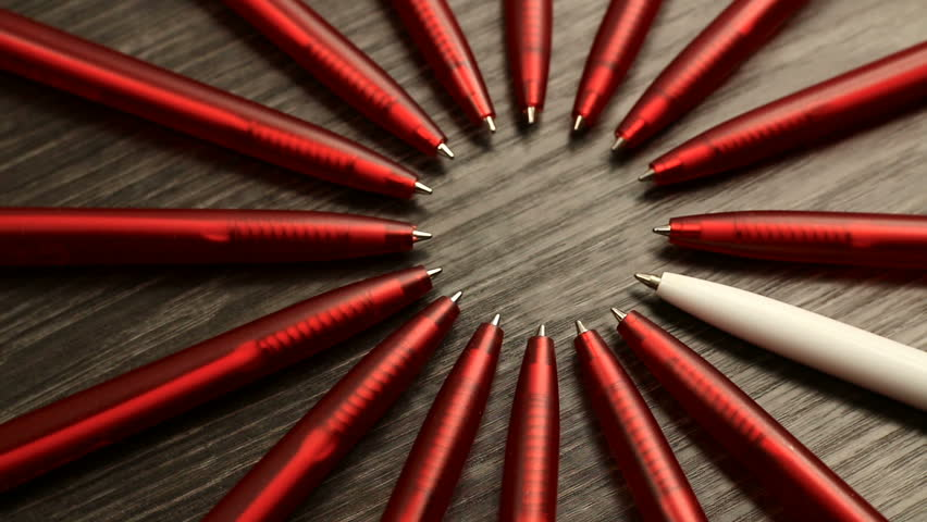A lot of red pens and one white move in a circle. Concept office or school, knowledge day, the first of September. Video footage is spinning rotate | Shutterstock HD Video #34753462