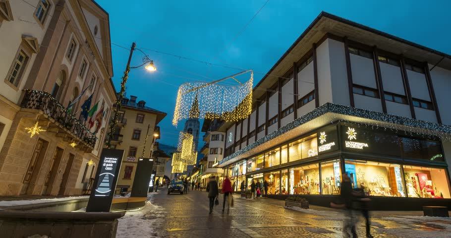 CORTINA, ITALY - CIRCA DECEMBER, 2017: La Cooperativa di Cortina mall. View at night time during Christmas. Time lapse footage.