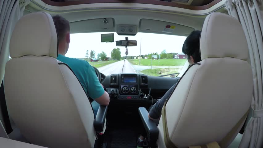 Man driving on a road in the Camper Van RV. Caravan car Vacation. Family vacation travel, holiday trip in motorhome