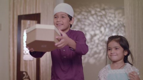 Cute Muslim Children come running to give surprise gifts to their parents on Eid Holiday
