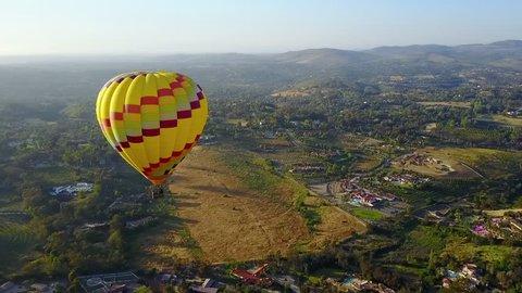 Close Aerial of Yellow Hot Air Balloon
