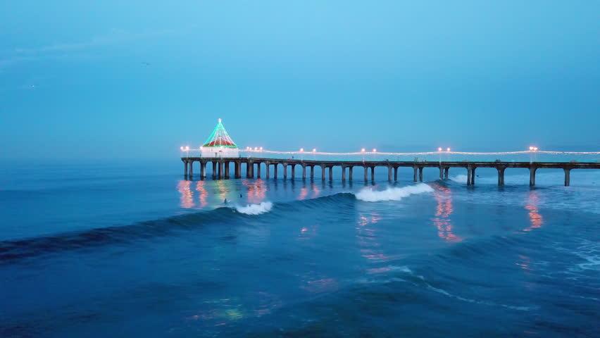 Aerial of Surfers and Pier of Manhattan Beach | Shutterstock HD Video #34800892