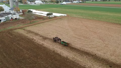 Amish Farmer Plowing Field With Horses