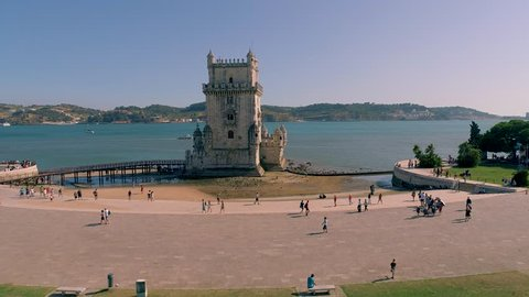 Portugal Lisbon Belem Tower Aerial view Tagus river Famous tower Summer  4k Peole around Tourists