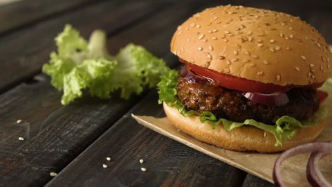 Homemade burger with beef and fresh vegetables.