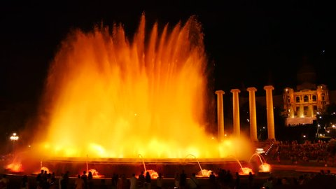 Barcelona Magic fountains attraction, a lot of tourists looking at colorful night show with different water shapes at late evening. Montjuic fontaine, Font magica de Montjuc.
