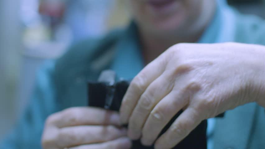 Slow motion detail shot inside a shoe repair shop. Fixing a leather boot zipper #34917592