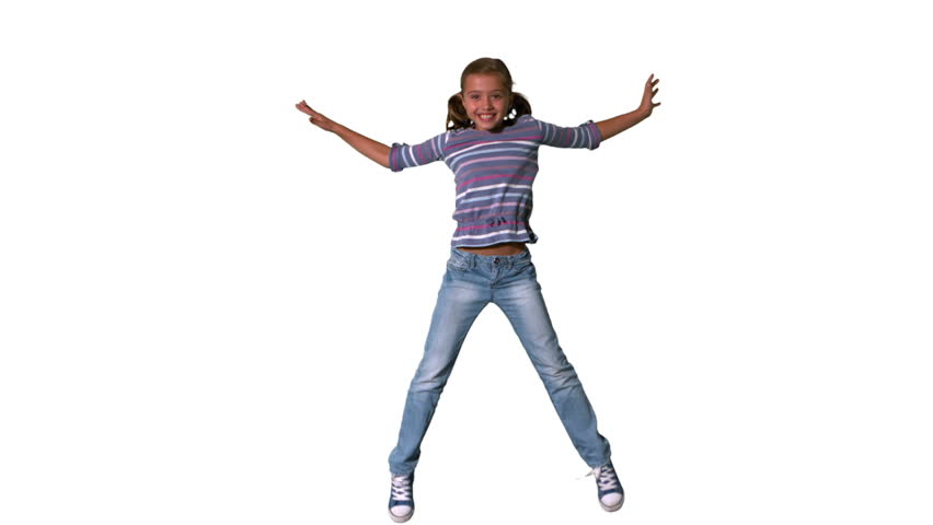 Happy girl jumping up and down on a white background in slow motion
