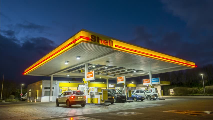 Hannover, Germany - January 16, 2018: Shell gas station at night in Hannover, Germany Timelapse
