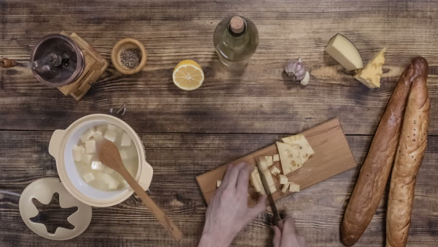 Cheese fondue. Traditional Swiss food. Stop motion animation