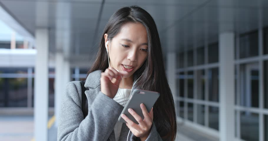 Woman talk to mobile phone on hand free | Shutterstock HD Video #35002993