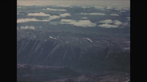 CIRCA - 1952 - A snow-capped mountain range in Kodiak, Alaska is filmed from an aircraft.