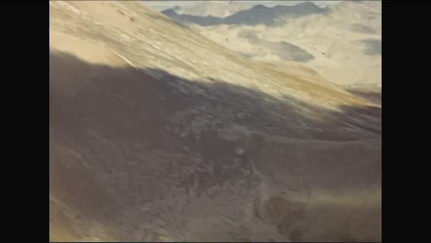 CIRCA - 1952 - Mountain ranges in Kodiak, Alaska are shot from a glider; the volcanic Novarupta crater is seen.