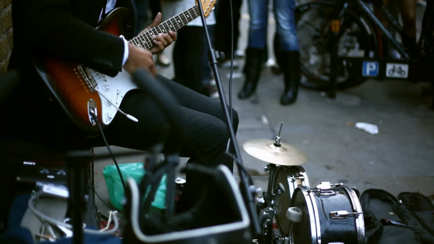 Guitar player performing on street | Shutterstock HD Video #3517412