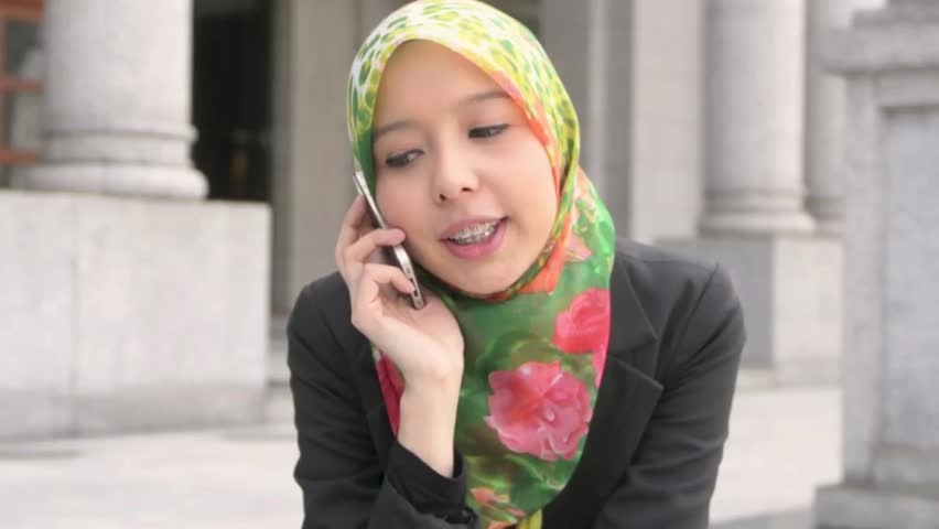 Scarf girl with braces teeth use cellphone