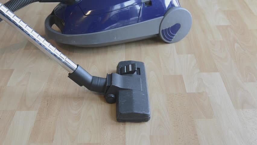 Stock Video Of Woman Vacuuming Wooden Floor 3571682 Shutterstock