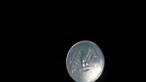 Coin Flip in Slow Motion with Alpha: A quarter flips through the air up from the bottom of the frame, reaches the apex of it's toss, and then falls out of frame. Alpha included. Shallow DOF 3D render.