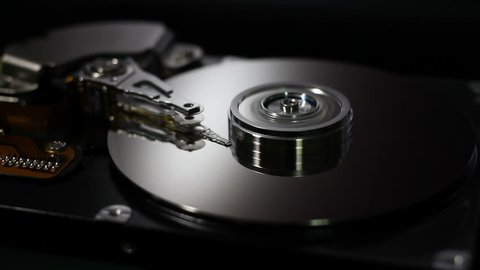 Operating hard disk drive on dark background.