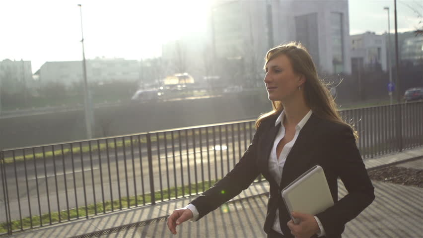 SLOW MOTION: Young businesswoman going to work in the morning | Shutterstock HD Video #3579872