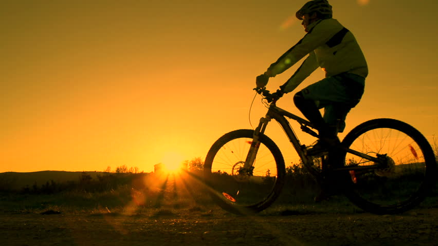 SLOW MOTION: mountain biker pulls a wheelie #3581282