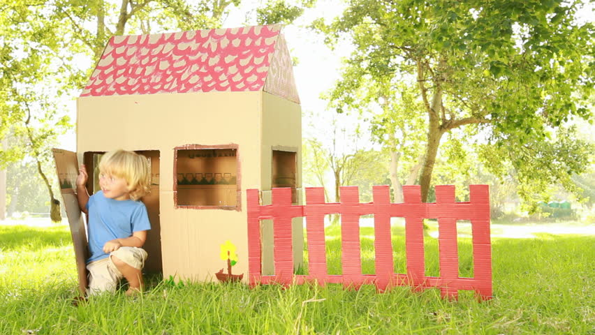 Video of happy little children sitting in playhouse.