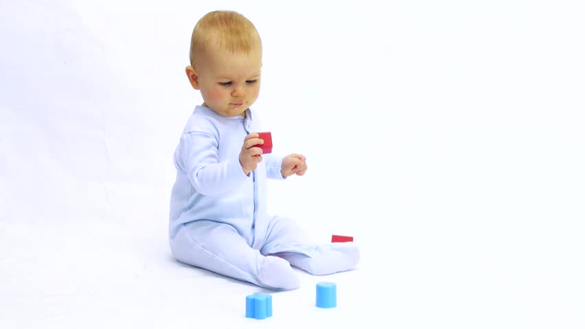 HD1080 Baby ( 6 month old) sitting and playing with a toy | Shutterstock HD Video #3611942