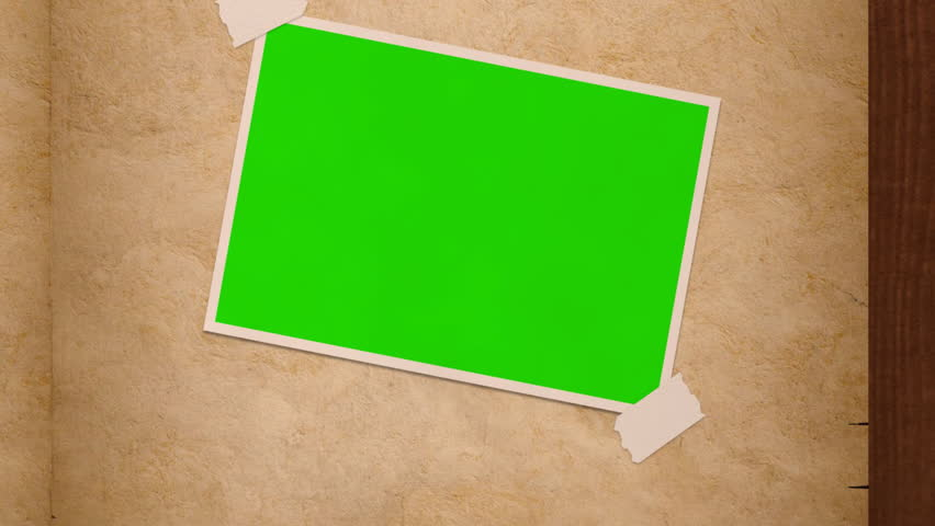 Computer-rendered animation of  turning photo album pages with green screen windows.