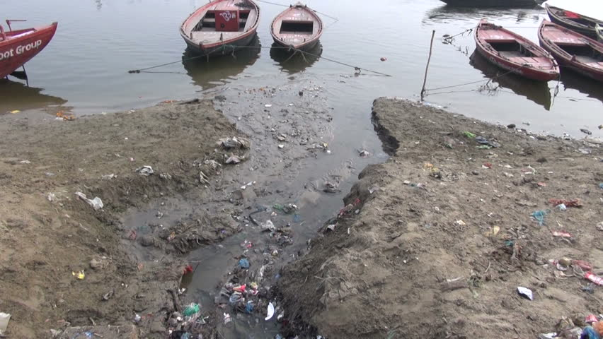 water pollution channel with rubbish near sacred Ganges river in Varanasi, India