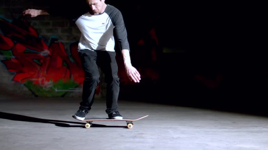 Skater doing backside 360 trick in slow motion