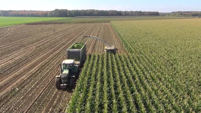 Aerial view of a farmer harvesting silage   Shutterstock HD Video #3623972