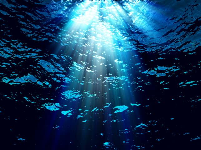 NTSC - Underwater light filters down through blue water (Loop).