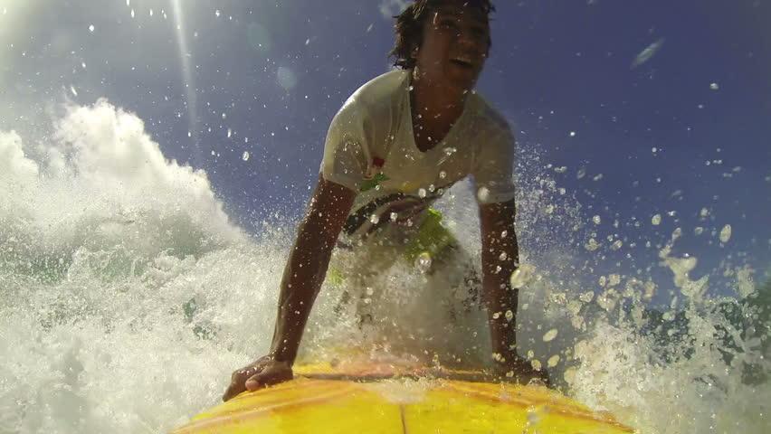 Professional surfer rides a tropical ocean wave