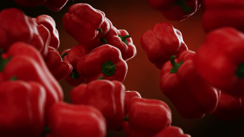 Red bell peppers with water droplets falling down in front of blurry background. Slow motion CG animation.
