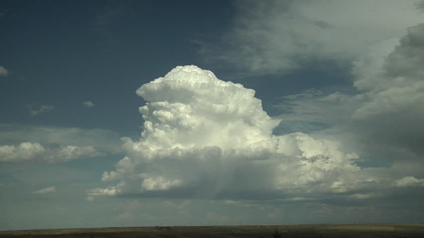 Thunderstorm with Hail. Hailshaft visible from isolated cumulonimbus