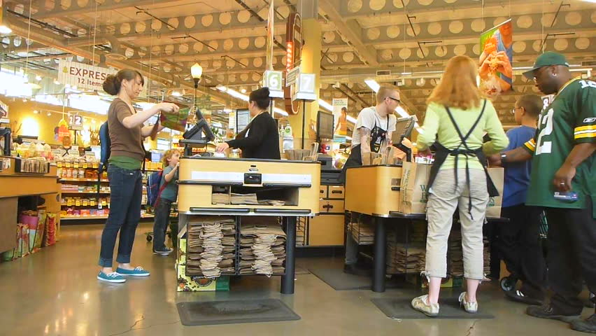 PORTLAND, OREGON - CIRCA 2012: People at grocery store check out line, time lapse.