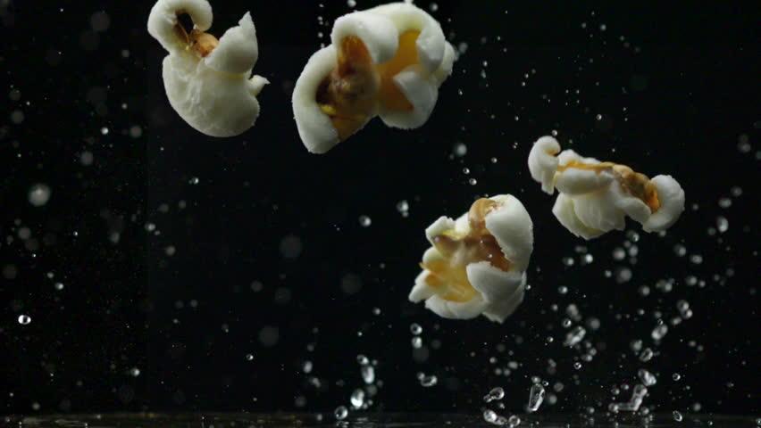 Popcorn popping on black background shooting with high speed camera, phantom flex.