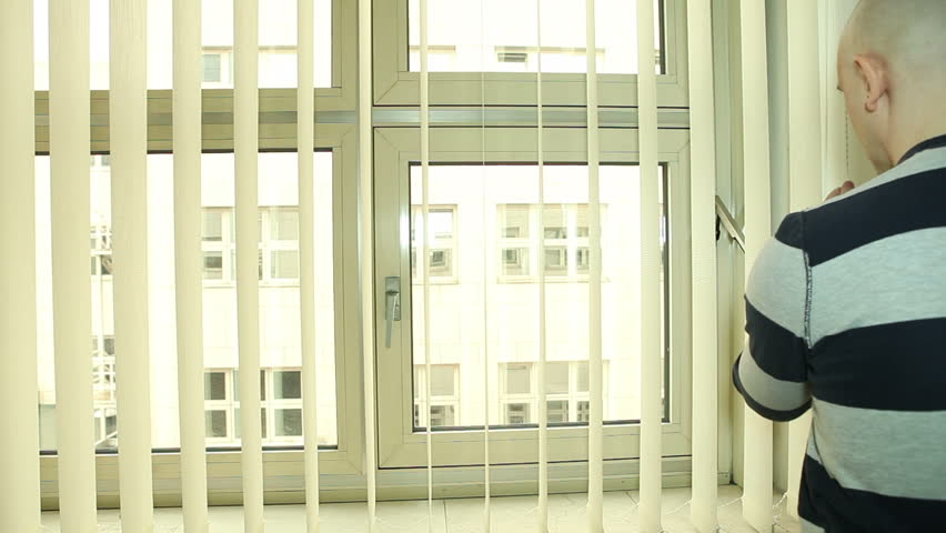 Man Closing And Turning Vertical Blinds On The Office Window   HD Stock  Footage Clip