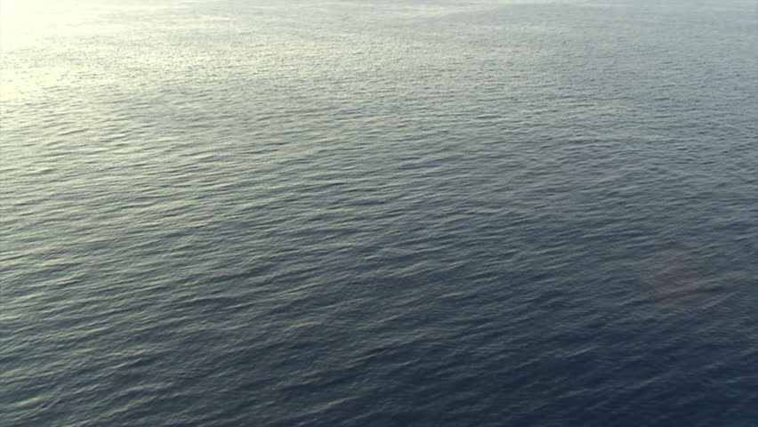 Flying low and fast over open sea. Aerial shot.