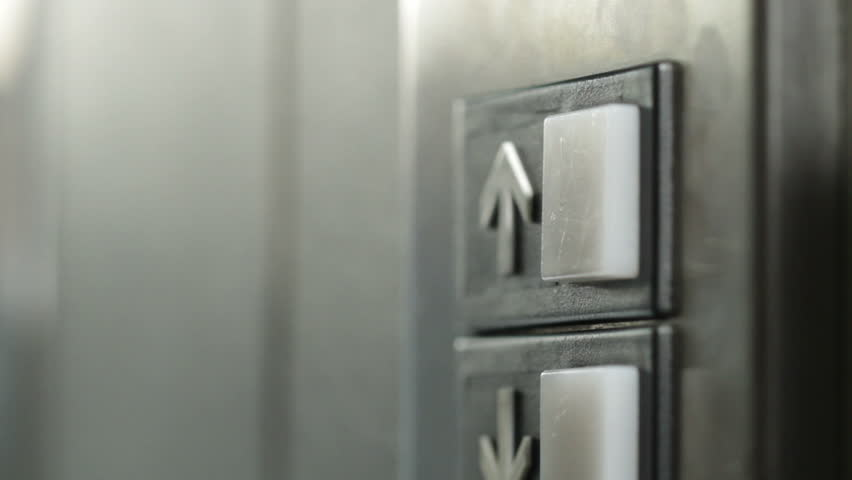 Manicured finger presses the button for an elevator but it doesn't light up, so they press it again and again. Dolly shot. | Shutterstock HD Video #3669779