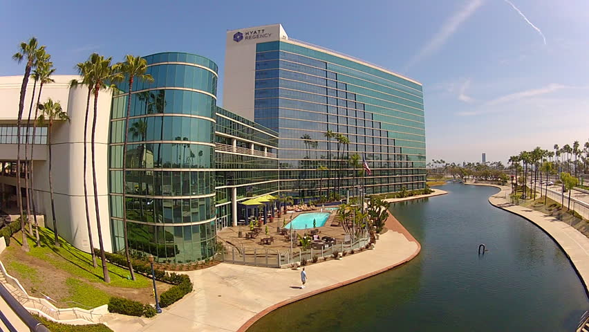 LONG BEACH, CA - APRIL 2, 2013: The Hyatt Regency Hotel lodges many tourists and convention goers at the Convention Center circa 2013 in Long Beach.  Adjacent to the hotel is Rainbow Lagoon Park.