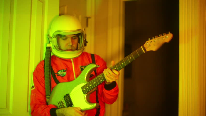 Nonsense concept. Astronaut with guitar