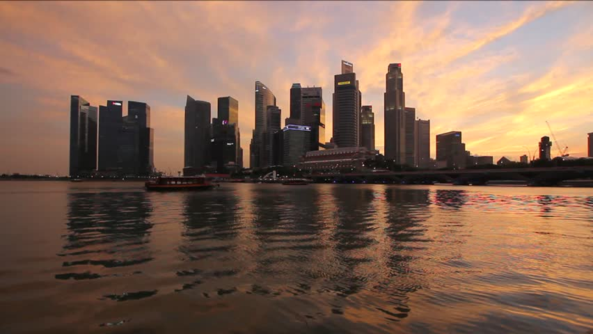 Singapore City Skyline with Office Skyscraper Buildings from Waterfront Esplanade along Singapore River with Water Reflection at Sunset 1920x1080