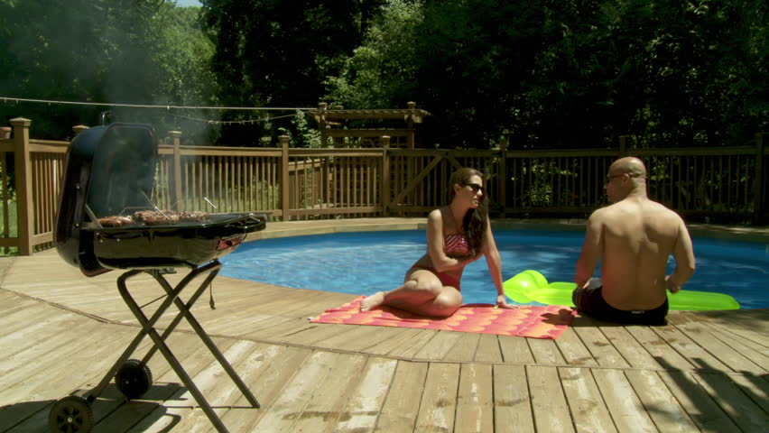 couple relaxing at swimming pool  stock footage video  100