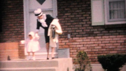 JOHNSTOWN, NEW YORK, 1964: A mother and daughter model their new Easter dresses in front of their home in 1964.
